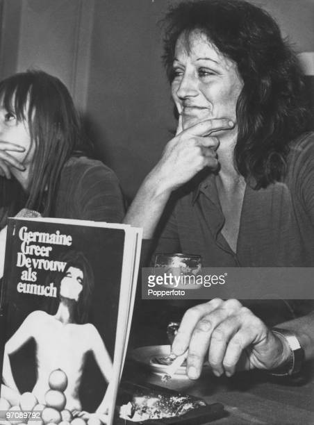 Australian feminist writer Germaine Greer with a Dutch edition of her best-known book, 'The Female Eunuch', 13th June 1972.