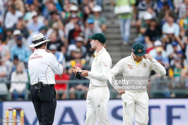 Australian fielder Cameron Bancroft is questioned by Umpires Richard Illingworth and Nigel Llong during the third day of the third Test cricket match...