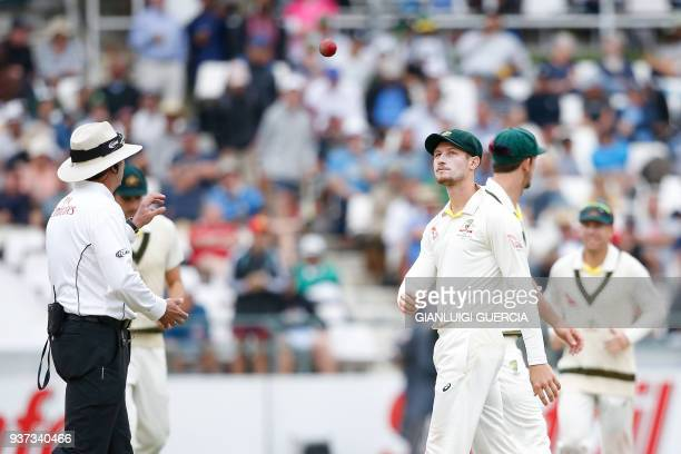 Australian fielder Cameron Bancroft throws the ball to Umpire Richard Illingworth during the third day of the third Test cricket match between South...