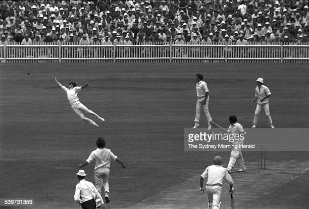 Australian fieldsman Greg Chappell dives and deflects a chance from World XI batsman Farokh Engineer off the bowling of Dennis Lillee during the...