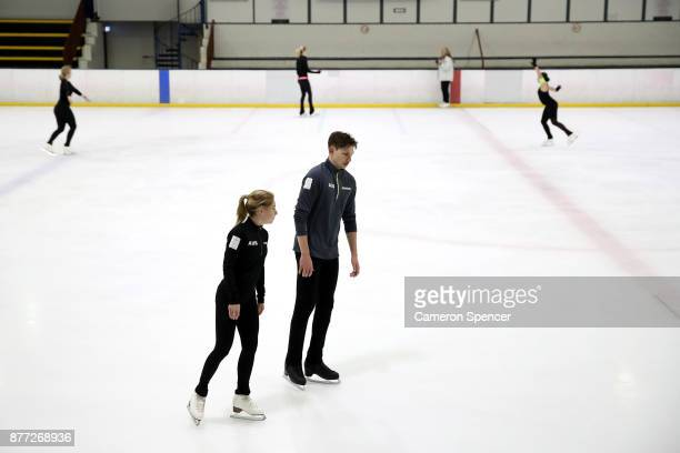 Australian figure skater Harley Windsor and his skating partner Ekaterina Alexandrovskaya discuss their routine as they skate during a training...