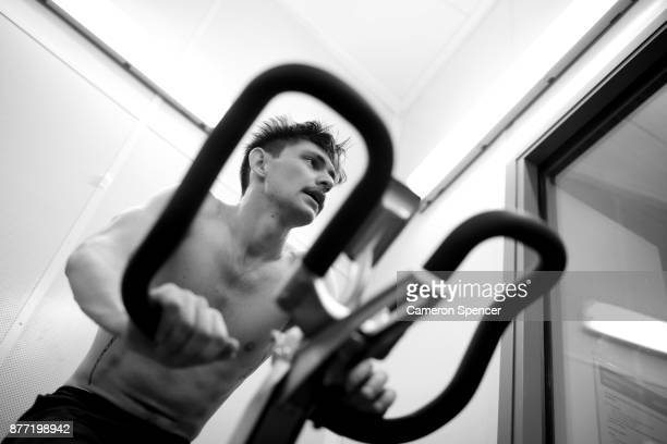 Australian figure skater Harley Windsor rides a stationary bike in an altitude training chamber at the New South Wales Institute of Sport on August...