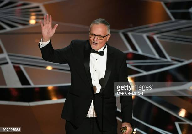 Australian Film Editor Lee Smith delivers a speech after he won the Oscar for Best Film Editing for 'Dunkirk' during the 90th Annual Academy Awards...