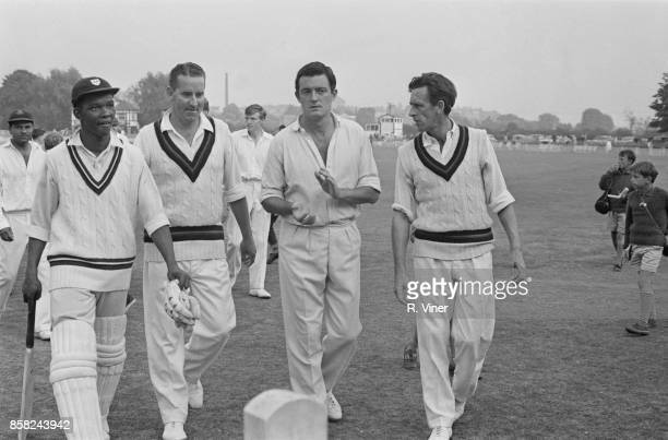 Australian first class cricketer Ken Grieves leaving the field with his teammates of Lancashire County Cricket Club after losing a game against...