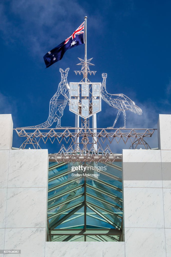 Australian Flag and Coat Of Arms Parliament House, Canberra, Australia : Stock Photo
