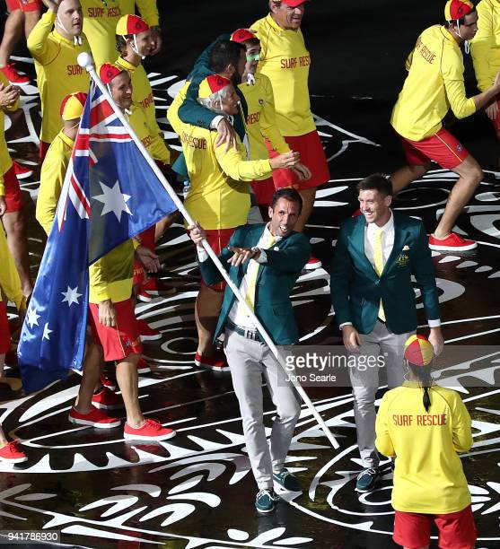 Australian flag bearer Mark Knowles carries the flag as the Australian team arrives to the stadium during the Opening Ceremony for the Gold Coast...