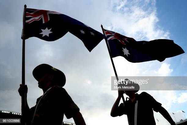 Australian flag bearers from the defence force are seen before the round eight NRL match between the St George Illawara Dragons and Sydney Roosters...