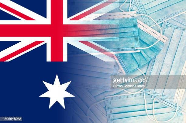 australian flag over face protective masks - australian flag stock pictures, royalty-free photos & images