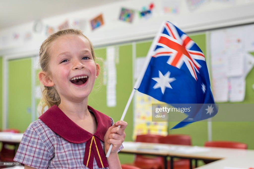 Australische Flagge winken von Grundschule Schüler für Australia Day : Stock-Foto