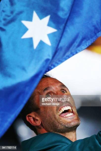 Australian Flagbearer Mark Knowles walks around with the team during the Opening Ceremony for the Gold Coast 2018 Commonwealth Games at Carrara...