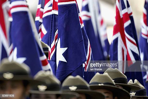Australian flags are paraded during the Anzac Day parade April 25 2005 in Sydney Australia Australians and New Zealanders today commemorate the 90th...