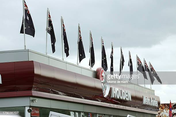 Australian flags fly above a Holden dealership sign in Thebarton on July 30 2013 in Adelaide Australia Holden a subsidiary of American car giant...