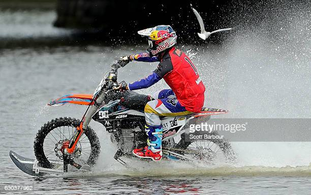 Australian FMX rider Robbie Maddison rides his motorbike along the surface of the Yarra River on December 22 2016 in Melbourne Australia The xXxTreme...