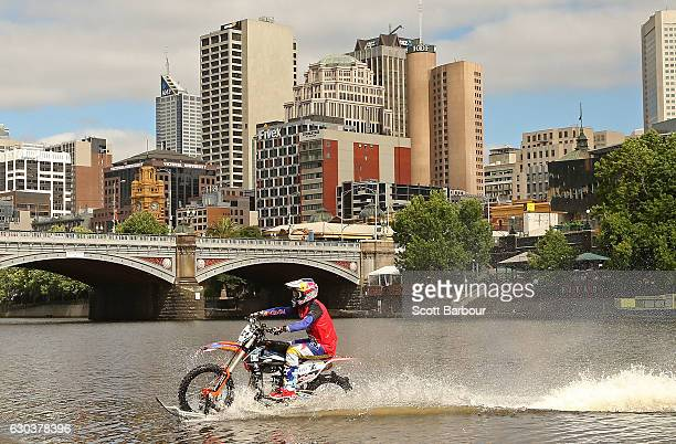 Australian FMX rider Robbie Maddison rides his motorbike along the surface of the Yarra River on December 22, 2016 in Melbourne, Australia. The...