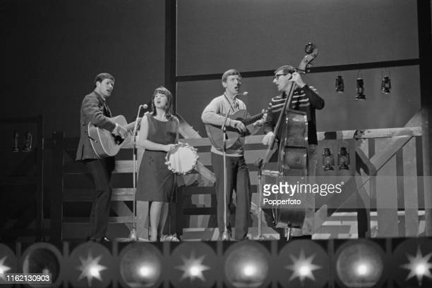 Australian folk group The Seekers featuring, from left, Keith Potger, Judith Durham, Bruce Woodley and Athol Guy, perform live on stage during...