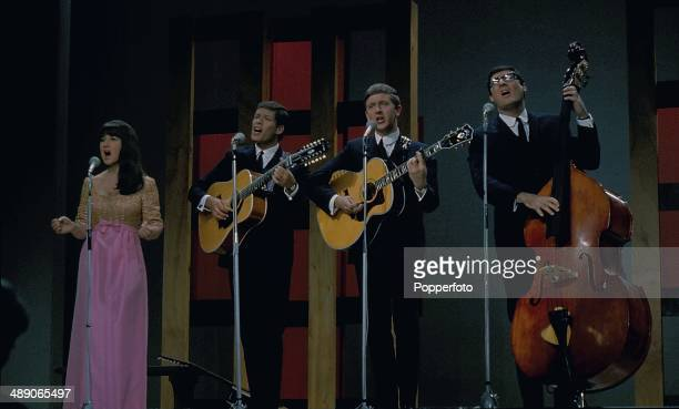Australian folk group The Seekers featuring singer Judith Durham, Keith Potger and Bruce Woodley and Athol Guy perform on stage at the Palladium Show...
