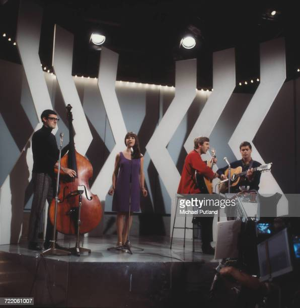 Australian folk group The Seekers perform on a television show in London circa 1965. The group are from left to right, double bass player Athol Guy,...