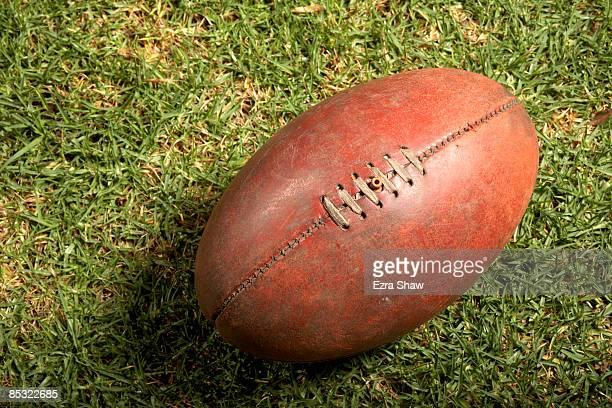 Australian football on green grass