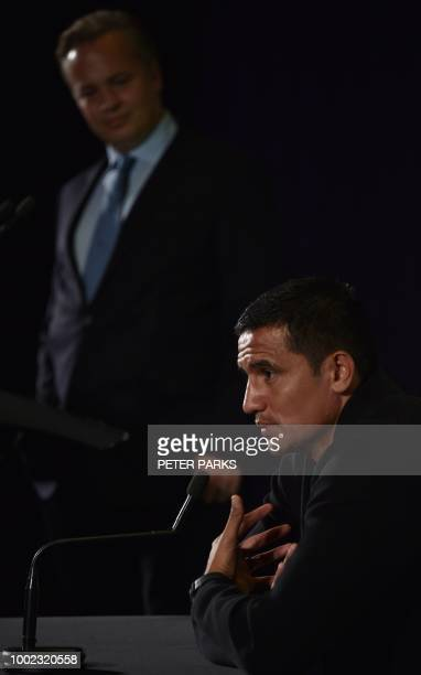 Australian football player Tim Cahill accompanied by Australian former goalkeeper and sports pundit Mark Bosnich speaks during a press conference...