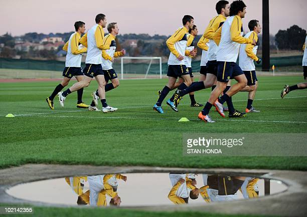 Australian football players run during a team training session at Ruimsig Stadium in Roodepoort on June 16 2010 during the 2010 World Cup football...