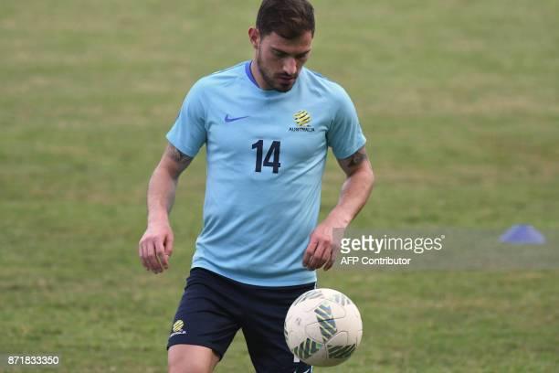 Australian footballer James Troisi controls the ball during a training session at Francisco Morazan stadium in San Pedro Sula 180 kilometres north of...