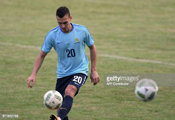 Australian footballer Trent Sainsbury controls the ball during a training session at Francisco Morazan stadium in San Pedro Sula 180 kilometres north...