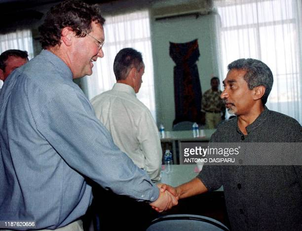 Australian Foreign Minister Alexander Downer shakes hands with his East Timorese counterpart Mari Alkatiri prior to their meeting in Dili 27 November...