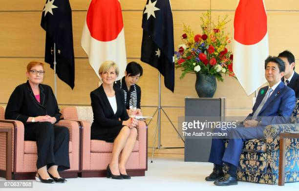 Australian Foreign Minister Julie Bishop and Defense Minister Marise Payne talk with Japanese Prime Minister Shinzo Abe during their meeting at Abe's...