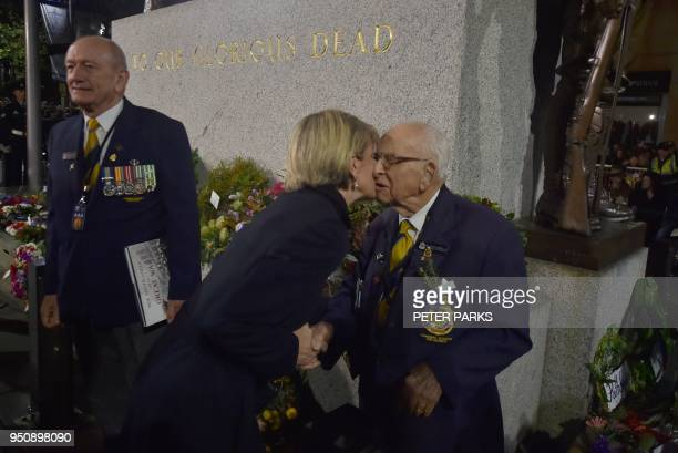 Australian Foreign Minister Julie Bishop kisses 95 yearold Walter 'Wally' ScottSmith who for the last 78 years has been the Chief Cenotaph Attendant...