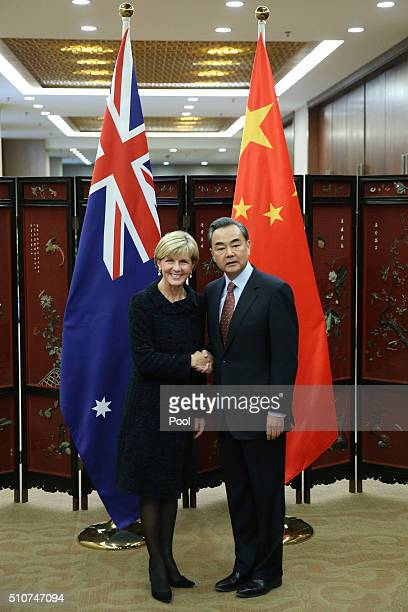 Australian Foreign Minister Julie Bishop shakes hands with Chinese Foreign Minister Wang Yi as she arrives for a meeting at the Ministry of Foreign...