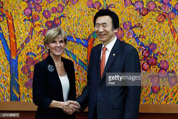 Australian Foreign Minister Julie Bishop shakes hands with South Korean Foreign Minister Yun ByungSe during their meeting at the foreign ministry od...