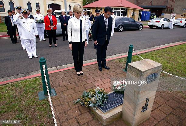 Australian Foreign Minister Julie Bishop stands with Japan's Foreign Affairs Minister Fumio Kishida after they laid a wreath at the HMAS Kuttabul...