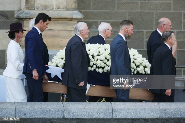 Australian Formula One champion Mark Webber helps carry the casket at the State Funeral Service for Ronald Walker at St Paul's Cathedral on February...