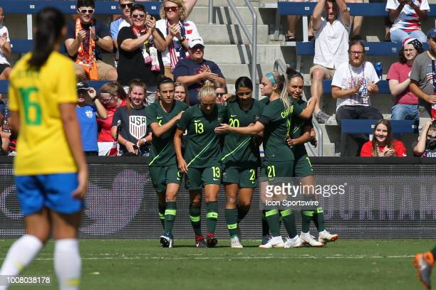 Australian forward Sam Kerr is congratulated by teammates after her goal in the second half of a women's soccer match between Brazil and Australia in...