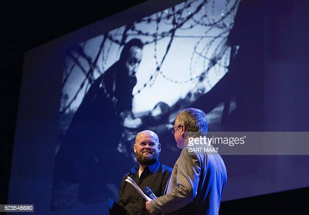 Australian freelance photographer Warren Richardson winner of the World Press Photo of the Year award and first prize singles in the Spot News...