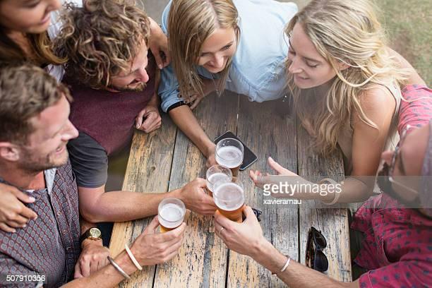 Australian friends hanging out in a terrace bar