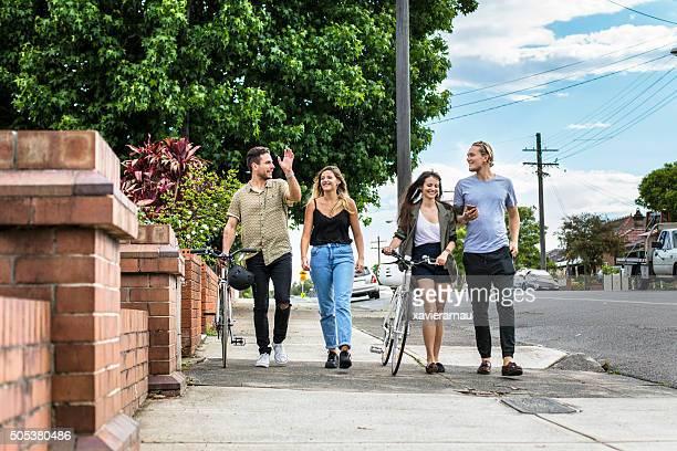Australian friends walking in the street on a sunny day