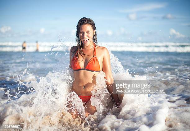 Australian girl coming out of the water at beach