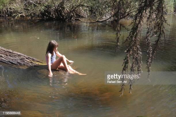 australian girl cooling down in margaret river waters - rafael ben ari bildbanksfoton och bilder