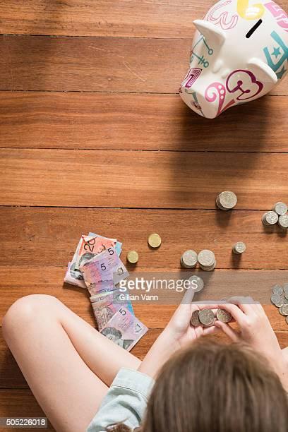 Australian girl counting money CNAPBUS909