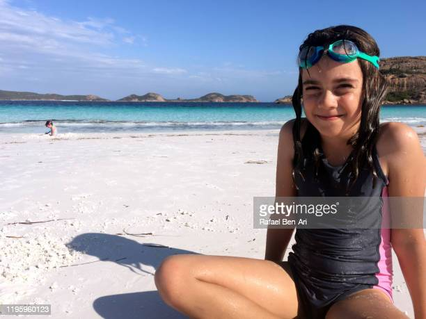 australian girl having fun in  lucky bay in cape le grand western australia - rafael ben ari stockfoto's en -beelden