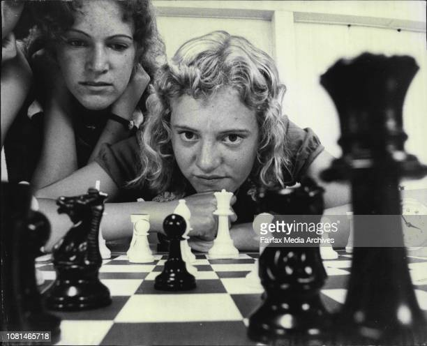 Australian Girls Junior Chess Championships 17 years old Gillian Miller of Adelaide Sth Australia ponders a move watched by her sister Cathy 16...