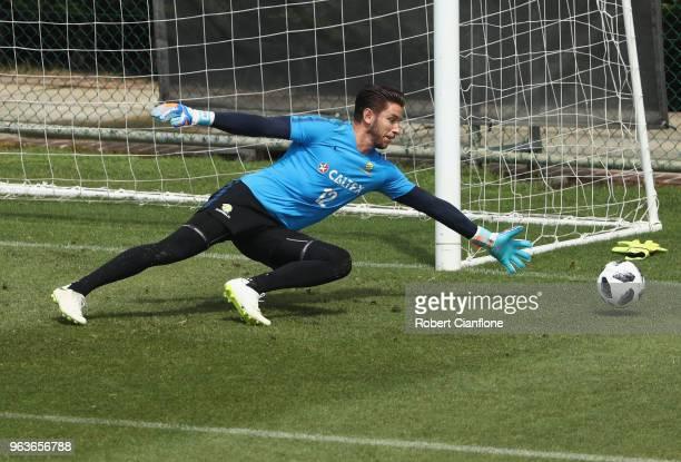 Australian goalkeeper Brad Jones makes a save during an Australian Socceroos training session at the Gloria Football Club on May 30 2018 in Antalya...