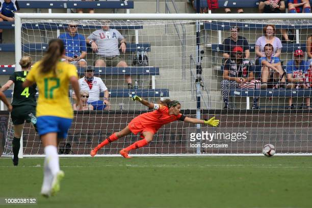 Australian goalkeeper Lydia Williams dives but can't stop a shot in the first half of a women's soccer match between Brazil and Australia in the 2018...