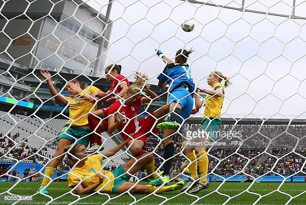 Australian goalkeeper Lydia Williams punches the ball clear during the Women's First Round Group F match between Canada and Australia at Arena...