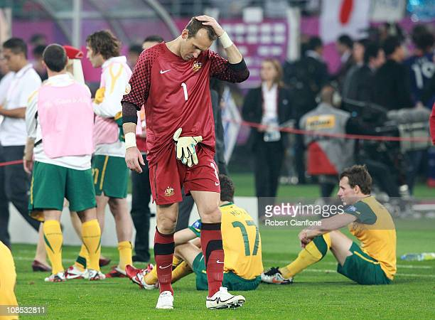Australian goalkeeper Mark Schwarzer looks dejected after Japan defeated Australia in extra time 10 at the AFC Asian Cup Final match between the...