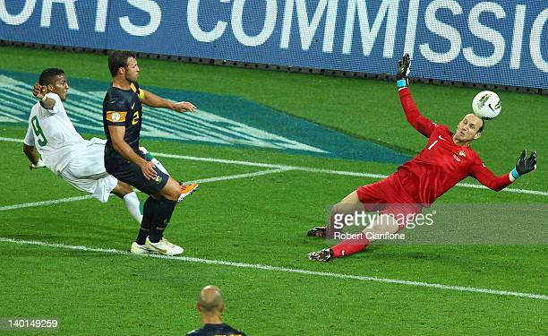 Australian goalkeeper Mark Schwarzer makes a save off Naif Ahmed Hazazi of Saudi Arabia during the Group D 2014 FIFA World Cup Asian Qualifier match...