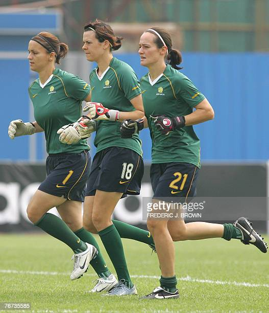 Australian goalkeepers Melissa Barbieri Lydia Williams and Emma Wirkus jog during a training session in Hangzhou 14 September 2007 in eastern China's...
