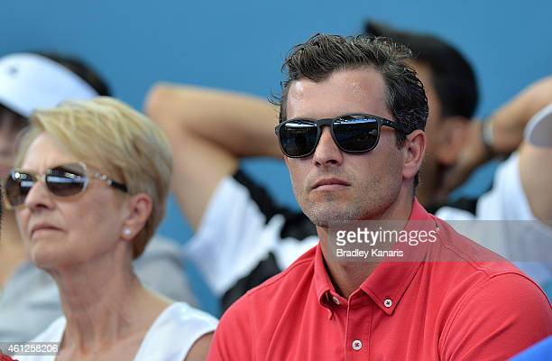 Australian golf player Adam Scott is seen watching on together with his mother Pam Scott in the Men's semi final match between Milos Raonic of Canada...