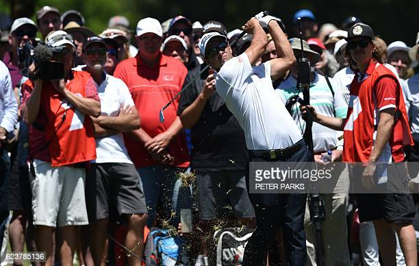 Australian golfer Adam Scott hits a ball on the fairway during day one of the Australian Open golf tournament at the Royal Sydney Golf Club in Sydney...